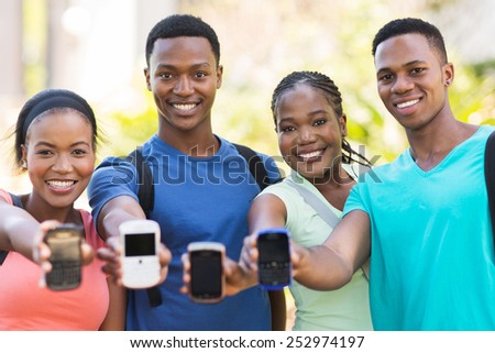 group african college students showing smart phones  - stock photo
