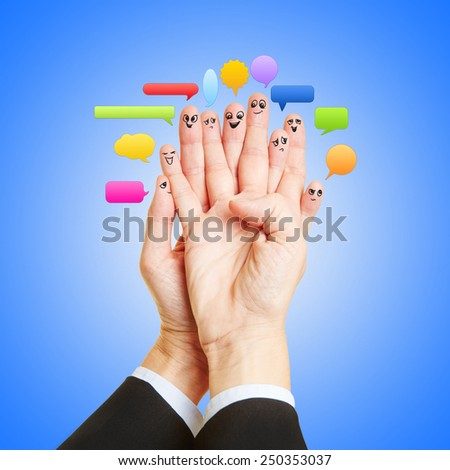 Group chat with speech bubbles and many funny smileys on fingers - stock photo