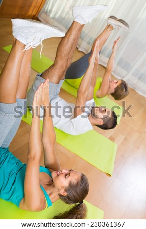 Group fitness class in sport club. Focus on girl - stock photo