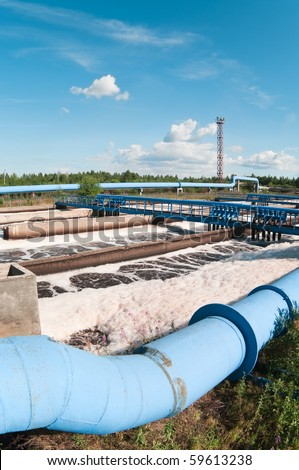 Group from the big sedimentation drainage. Water recycling, settling, purification in the tank by biological organisms on the water station. - stock photo