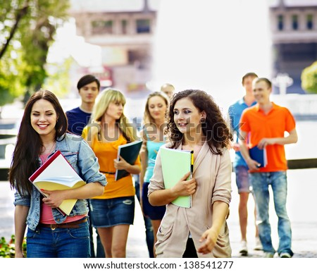 Group happy student with notebook  outdoor. - stock photo