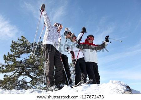 Group in ski holidays - stock photo