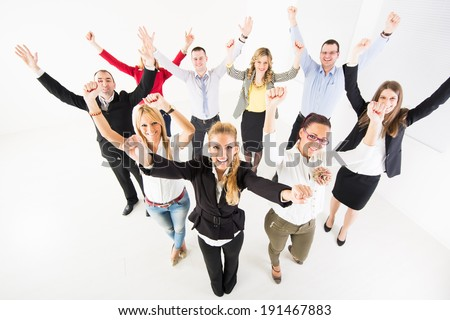 Group of a happy Business People standing together with raised arms. - stock photo