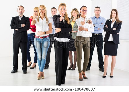 Group of a Successful Business People Showing Thumbs Up and looking at the camera. - stock photo