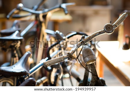 Group of a vintage bicycle handlebars in second hand shop - stock photo