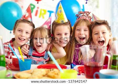 Group of adorable kids having birthday party - stock photo