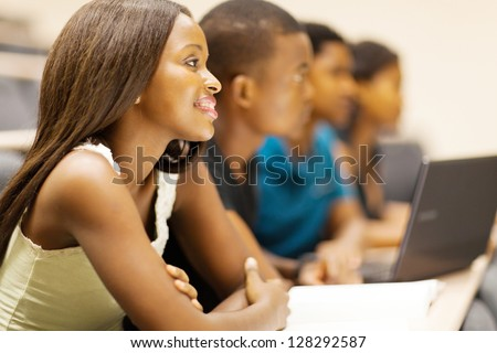 group of african american university students in lecturing hall - stock photo