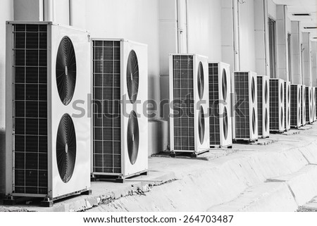Group of air conditioner outdoor units outside of building - stock photo