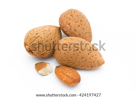 Group of almond nuts. Isolated on a white background. - stock photo