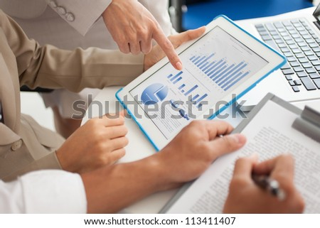 Group of analysts working on digital data to forecast next strategic movement - stock photo