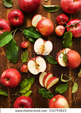 Group of apples on the wooden background. Viewed from above. - stock photo