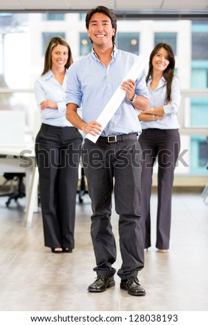Group of architects at the office with leader holding blueprints - stock photo