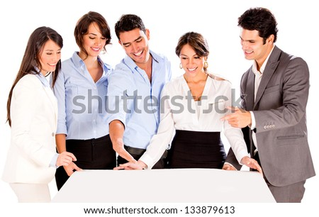 Group of architects holding a mockup - isolated over white - stock photo