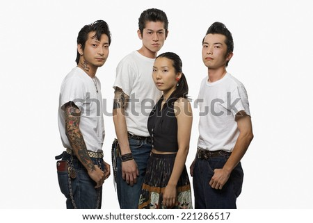 Group of Asian friends in rockabilly clothing - stock photo