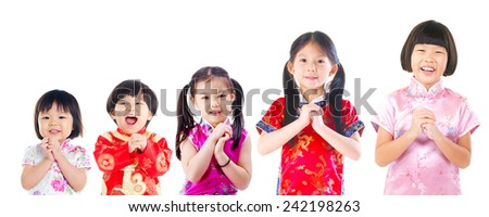 Group of asian kids in wishing gesture. Chinese new year concept. - stock photo