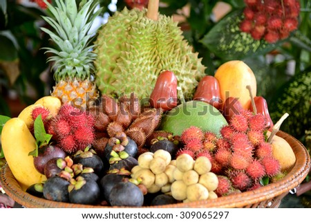 Group of Asian or Tropical fruit in basket, Thailand - stock photo