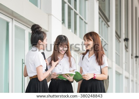 Group of asian students in uniform studying together at university - stock photo