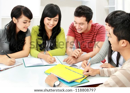 Group of asian students studying together at home - stock photo