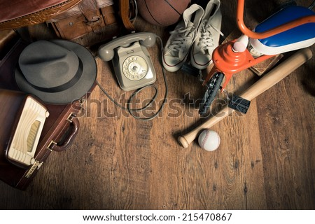 Group of assorted vintage items on hardwood floor at flea market. - stock photo