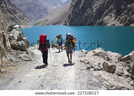 group of backpackers hiking in high mountains of central Asia, Tajikistan - stock photo