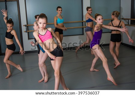 Group of ballet dancers having fun in studio - stock photo