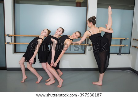Group of ballet dancers in studio - stock photo