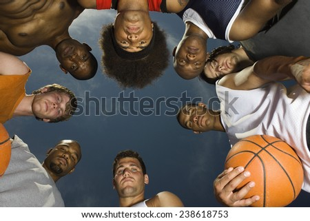 Group of Basketball Players Standing in Circle - stock photo