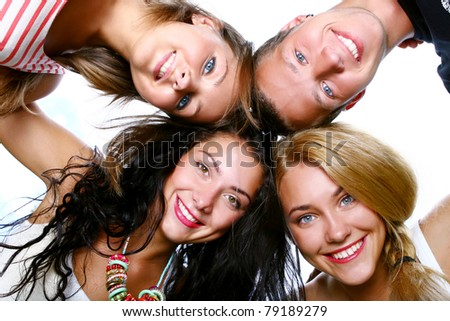 Group of beautiful and cheerful teenagers - stock photo