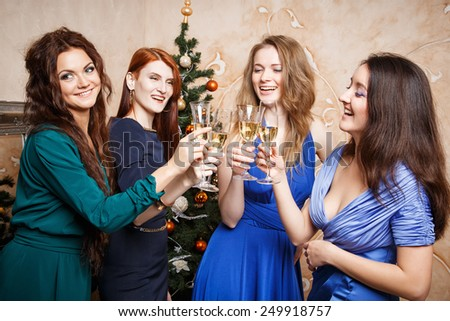 Group of beautiful young women with glasses of champagne celebrating New Year - stock photo
