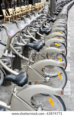 Group of bicycles on the sidewalk. Photo with tilt-shift lens - stock photo