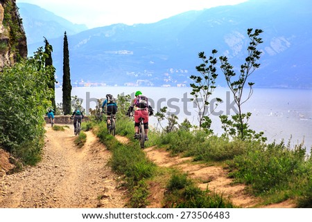 Group of biker in front of Garda lake in Italy - stock photo