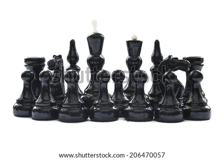 Group of black chess pieces isolated over white - stock photo
