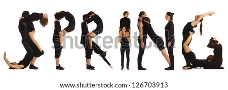 Group of black dressed people standing over white forming SPRING word - stock photo