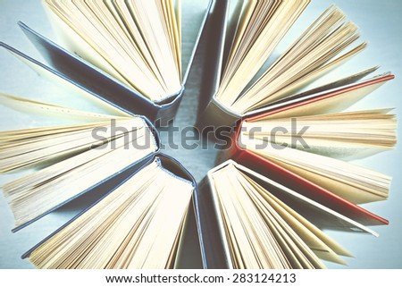 Group of books on light blue background, top view - stock photo