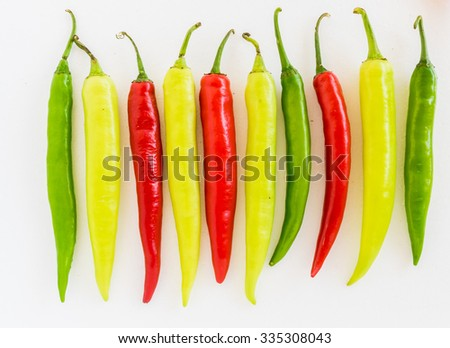 Group of both red and green freshly picked ripe chili peppers. Red chilies contain large amounts of vitamin C and small amounts of carotene (provitamin A). - stock photo