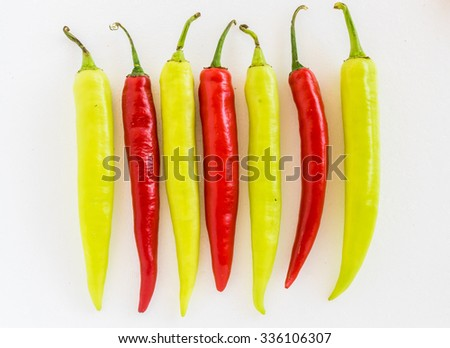 Group of both red and green freshly picked ripe chili peppers. Red chilies contain large amounts of vitamin C and small amounts of carotene (provitamin A), top view - stock photo
