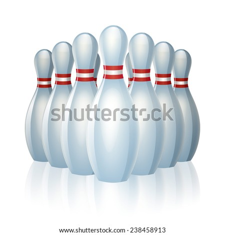 Group of bowling pins at the end of a bowling alley. - stock photo