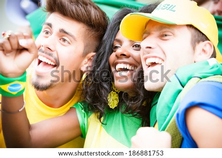 Group of brazilian supporters at stadium - Stock Image - stock photo