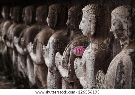 Group of buddha statue in Sukhothai Historical Park.The park was declared a World Heritage Site on 1991, it open to the public to watch and allowed to take photos . No restriction in copy or use. - stock photo