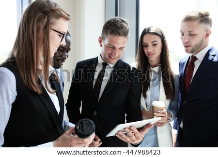 Group of buisness people working on tablet  - stock photo