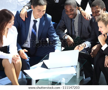 Group of business colleague in a meeting together at office - stock photo