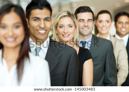 group of business executives standing in a row - stock photo