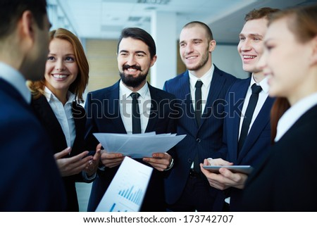 Group of business partners explaining ideas at meeting in office - stock photo