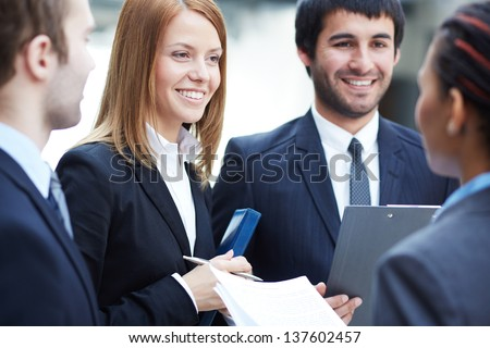 Group of business partners negotiating - stock photo