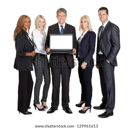 Group of business people advertising a new laptop computer over white background - stock photo