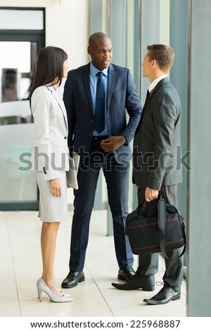 group of business people chatting after the meeting - stock photo
