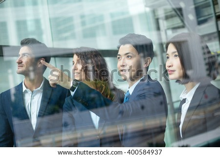 Group of business people discuss about the project inside office - stock photo