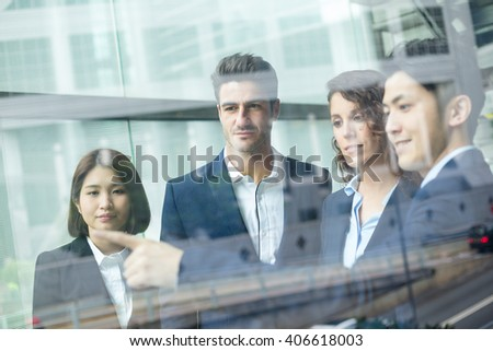 Group of business people discuss something inside office - stock photo