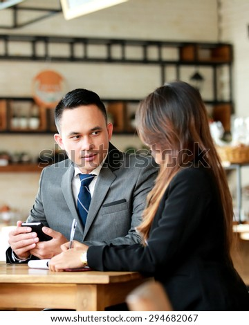 group of business people discussing about future plan at cafe - stock photo