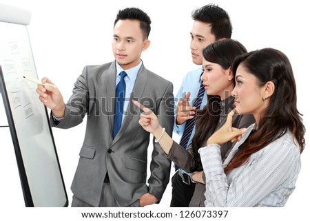 Group of business people discussing and looking at whiteboard isolated on white background - stock photo